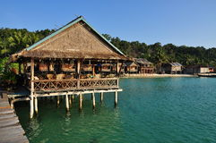 Traditional architecture, Koh Rong island, Cambodia. Koh Rong island, Cambodia. Traditional pile dwelling, wooden bungalow architecture on a beach in a tropical Stock Photos