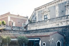 Traditional architecture of Sicily in Italy, historical street of Catania, facade of old buildings.  stock photos