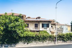 Traditional architecture of Sicily in Italy, historical street of Catania, facade of old buildings.  royalty free stock images