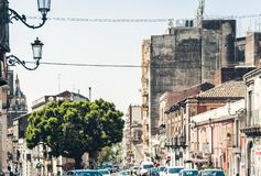 Traditional architecture of Sicily in Italy, historical street of Catania, facade of old buildings.  stock photo