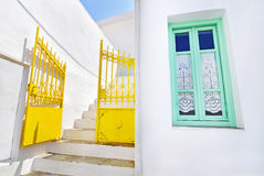 Traditional architecture Sifnos island Cyclades Greece. Yellow door and green window Royalty Free Stock Photos