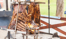 Traditional Argentinian asado roasted lamb grilled meat. Royalty Free Stock Photos