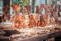 Traditional Argentinian asado roasted lamb grilled meat. stock image