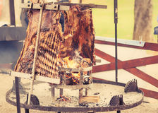 Traditional Argentinian asado roasted lamb grilled meat. Stock Images