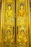 Traditional art on thai temple door Stock Images