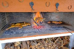 Traditional asado of a whole pork on a typical uruguayan grill with fireplace, Uruguay, South America. Traditional dish in Argentina, Paraguay, Chile and royalty free stock images