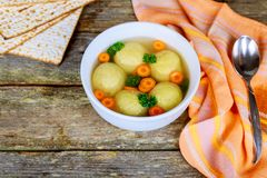 A traditional Ashkenazi Jewish soup with matzo balls, made from a mixture of matzah. Meal, chicken bouillon matzah, Jewish symbols for the Passover Pesach Stock Image