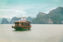 Traditional asian boat cruise in Vietnam Royalty Free Stock Photo