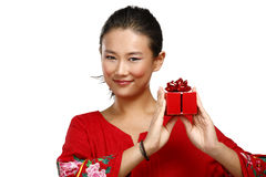 Traditional asian chinese woman with a gift in her hands Stock Photography