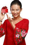 Traditional asian chinese woman with a gift in her hands Stock Images