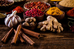 Traditional Asian concept with spices in wooden bowls Royalty Free Stock Images