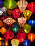 Traditional asian culorful lanterns on chinese market. Traditional asian round culorful lantern lamp selling on chinese market in Vietnam. Colored red, yellow Royalty Free Stock Photo