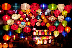 Traditional asian culorful lanterns on chinese market. Traditional asian round culorful lantern lamp selling on chinese market in Vietnam. Colored red, yellow Stock Image