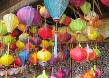 Traditional asian culorful lanterns on chinese market. Traditional asian round culorful lantern lamp selling on chinese market in Vietnam. Colored red, yellow Royalty Free Stock Photography