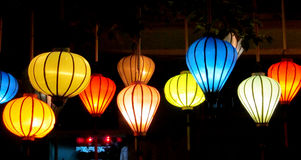 Traditional asian culorful lanterns at night chinese market. Traditional asian round culorful lantern lamp selling on chinese market in Vietnam. Colored red Stock Photos