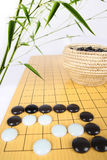 Traditional asian cultures,bamboo and the game of go. Eastphoto, tukuchina,  traditional asian cultures,bamboo and the game of go Royalty Free Stock Photos