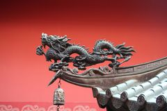 Traditional Asian Dragon. A noble roof dragon used to lure in prosperity into the temple stock photos