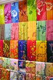 Traditional asian fabrics. And clothes for sale in a shop in Malaysia Royalty Free Stock Photos