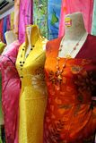 Traditional asian fabrics. And clothes for sale in a shop in Malaysia Stock Photo