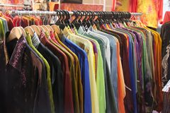 Traditional asian fabrics. And clothes for sale in a shop in Malaysia Royalty Free Stock Photography