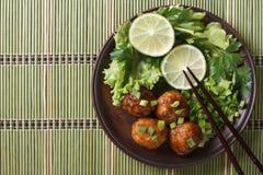 Traditional Asian fish balls with salad closeup. top view horizo Royalty Free Stock Image
