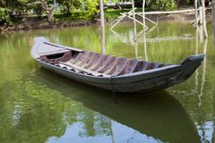 Traditional asian fishing boat in river, vietnam. Stock Photo