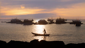 Traditional asian fishing at sunset Royalty Free Stock Images