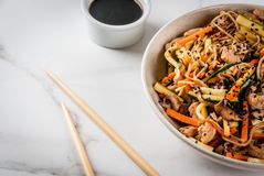 Stirfry with noodles, pork and vegetables royalty free stock images