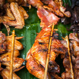 Traditional asian food at market. Delicious grilled chicken Stock Image