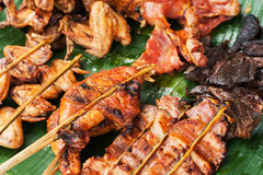 Traditional asian food at market. Delicious spicy grilled chicken Royalty Free Stock Images