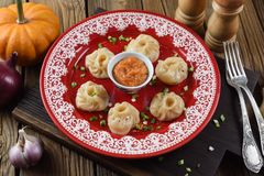 Traditional Asian food. Nepalese dumplings momo with curry sauce Royalty Free Stock Image