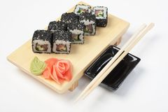 Traditional Asian food sushi. On wooden plate royalty free stock photography