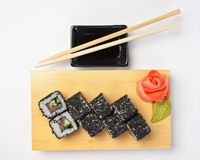 Traditional Asian food sushi. On wooden plate stock image