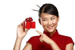 Traditional asian girl showing a christmas gift Stock Photo