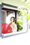 Traditional Asian Japanese beautiful Geisha woman bride wears kimono with red umbrella on hand in a summer nature. Japanese woman with kimono Japanese bride Stock Images