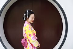 Traditional Asian Japanese beautiful Geisha woman wears kimono in a summer nature Stock Image