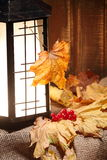Traditional Asian Lantern with autumn Decorations on Rustic Wood - Stock Image. Stock Image