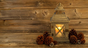 Traditional Asian Lantern Glowing Brightly with natural pine con Stock Images