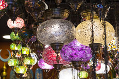 Traditional Asian lanterns of colored glass. On the market Royalty Free Stock Image