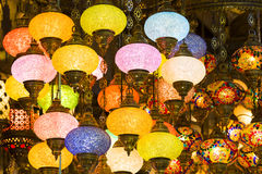 Traditional Asian lanterns of colored glass. On the market Stock Photography