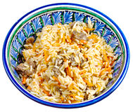 Traditional asian pilaf in ceramic bowl Stock Photos