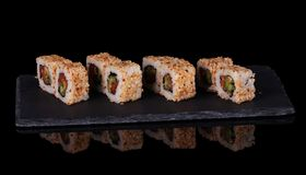 Traditional Asian platter of sushi on special stand, isolated on black. Background Stock Images