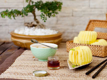 Traditional asian rice cake with honey and green tea Stock Image
