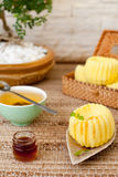 Traditional asian rice cake with honey and green tea Stock Photo