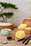 Traditional asian rice cake with honey and green tea Royalty Free Stock Image