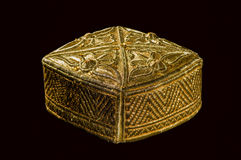 Traditional asian skullcap. Gold colored traditional asian skullcap cap on a black background Royalty Free Stock Image