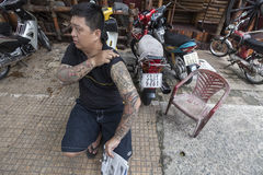 Traditional Asian tattoo. Man with classical tattoos that can be seen in Asia. There is long tradition of tattoos in Asian countries. Mostly that have religious stock photography