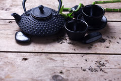 Traditional asian tea set  on aged wooden background. Royalty Free Stock Image