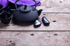 Traditional asian tea set  on aged wooden background. Royalty Free Stock Photography