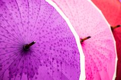 Traditional Asian umbrellas in market Stock Images